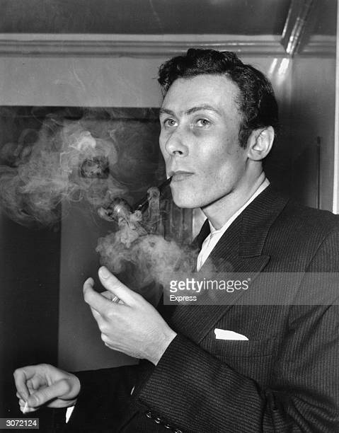 Playwright John Osborne Author of 'Look Back In Anger' and 'The Entertainer' enjoys a pipe