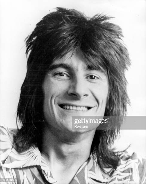 27 year old British rock guitarist Ron Wood of Rod Stewart's Faces is also joining the Rolling Stones parttime for tours and recording whilst...