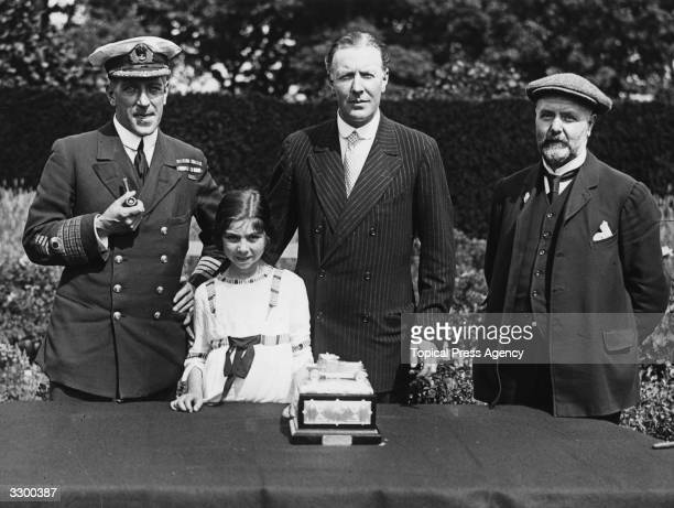 A presentation to the 2nd Duke of Westminster Hugh Richard Arthur Grosvenor by the survivors of HMS Tara With the Duke is his daughter and on the...