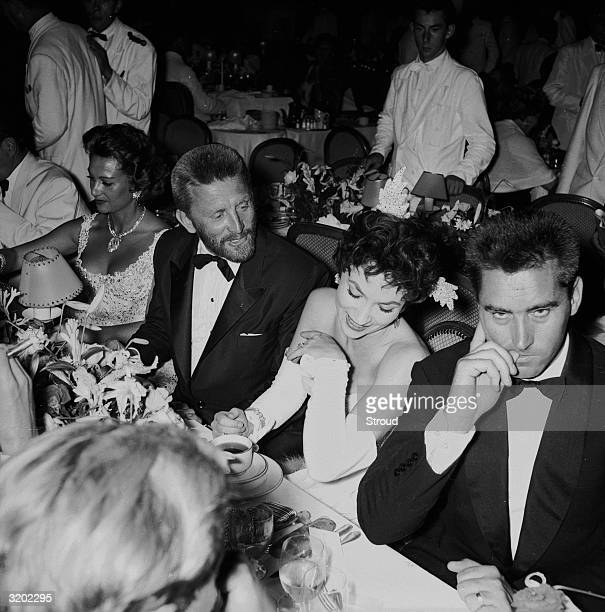 French actress Martine Carol with Kirk Douglas Gina Lollobrigida and her husband Milko Skofic at a benefit party in the Sporting Club in Monte Carlo...