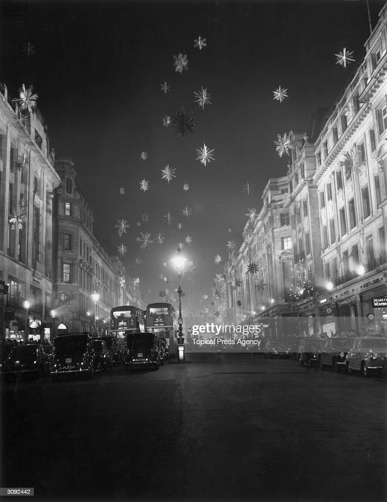 Snow flake Christmas decorations illuminated by floodlights in London's Regent Street