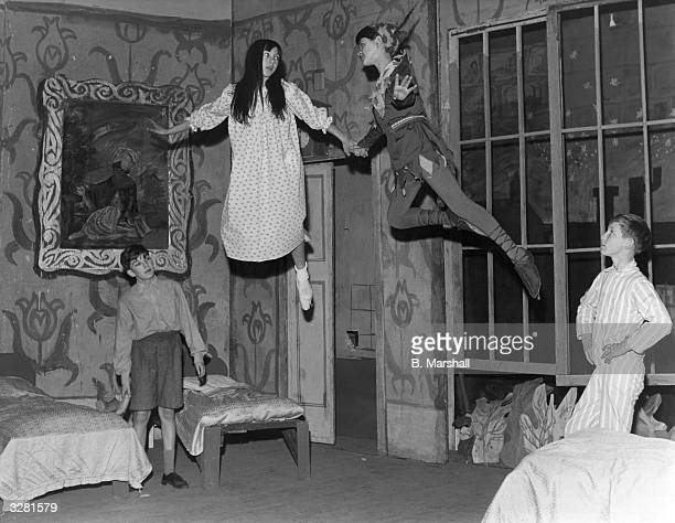 In a production staged by pupils of Blackwell Secondary School of Harrow Weald Middlesex as their Christmas play Peter Pan teaches the children to fly