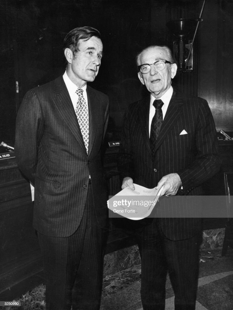 American politician George Bush later the 41st President of the United States and American senator John Stennis confer after hearings at the US...