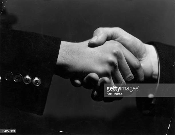 A closeup of two hands grasping each other in a firm handshake