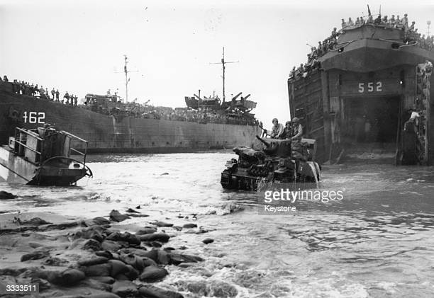 American tanks leaving an American landing ship at Lingayen Gulf beach in their attack on the Philippines