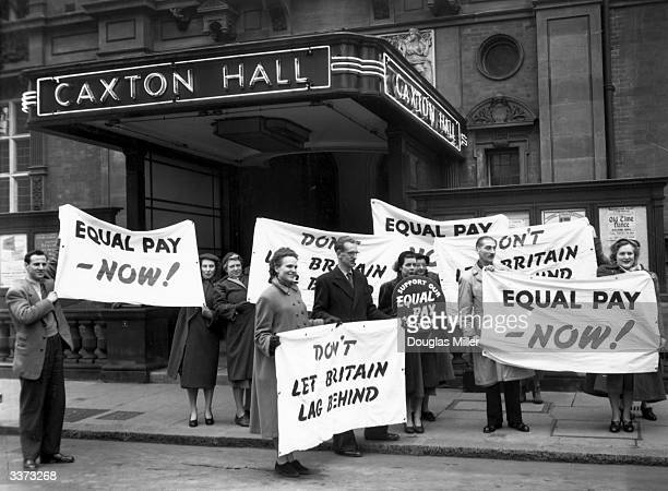 Protestors call for equal pay for women at Caxton Hall where a press conference highlighting the campaign for equal rights for women