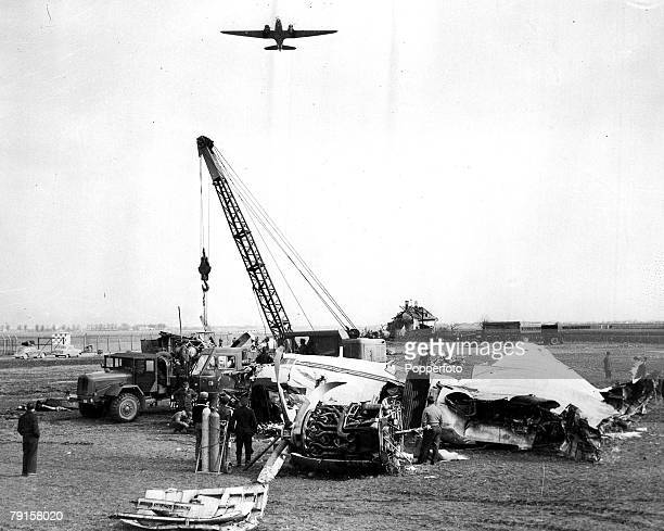 A crane removing the wreckage of the BEA Elizabethan airliner GALZU 'Lord Burghley' from Reim airport Munich where 23 people lost their lives...
