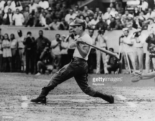 Major Ramiro Valdes vice prime minister of the Revolutionary Armed Forces of Cuba and member of the Cuban Communist party batting the first ball in...