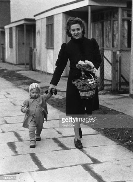Mrs M Miller and her 18 month old baby Ronald live in a prefabricated dwelling in Cubitt Town on the Isle of Dogs London