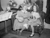 Tessie O'Shea the music hall singer and Jacqueline Boyer who is 15 years old rehearse a new song in the dressing room at Wimbledon Theatre where they...