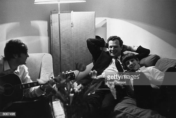 Band manager Brian Epstein relaxing in Paris with Beatles members John Lennon and Ringo Starr