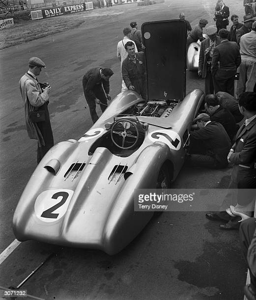 Engineers at work on a Mercedes racing car during a practice for the Grand Prix race at Silverstone in Northamptonshire