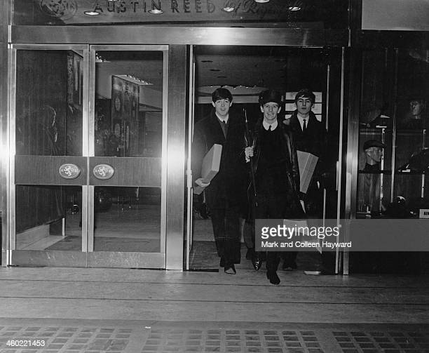 The Beatles posed at the entrance to Austin Reed store in Regent Street London on 16th July 1963 Left to right Paul McCartney Ringo Starr and George...