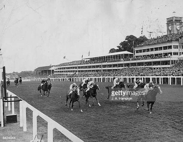 The finish of the Queen Anne Stakes at Royal Ascot won by Manny Mercer on Argur from J Lindley on Kng's Mistake and W Carr on Tip The Bottle