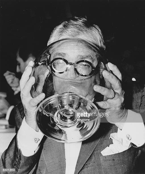 French playwright Marcel Achard takes a drink to celebrate the opening of the Museum of Western Art which is to house the Matsukata collection...