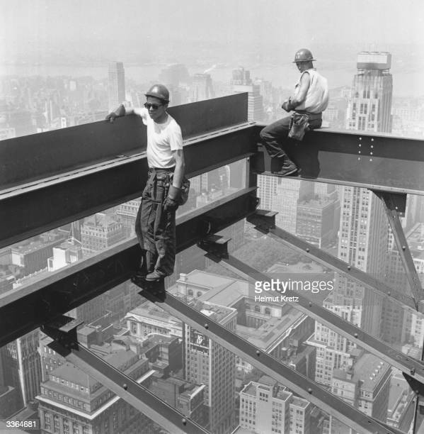 Two construction workers on the Pan American Building standing on girders 59 storeys above the New York streets