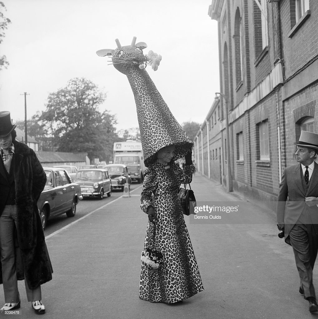 Gertrude Shilling, mother of hat designer and milliner David Shilling, with one of her son's characteristically flamboyant hats which she wears annually to Ascot. This year she is found modelling a leopard skin designed giraffe hat with a matching full length dress.