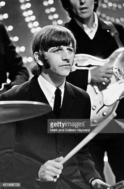 Ringo Starr and George Harrison behind from The Beatles perform 'Rain' and 'Paperback Writer' on BBC TV show 'Top Of The Pops' in London on 16th June...