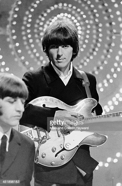 Ringo Starr and George Harrison from The Beatles perform 'Rain' and 'Paperback Writer' on BBC TV show 'Top Of The Pops' in London on 16th June 1966