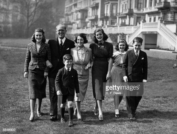 Joseph Patrick Kennedy the American Ambassador and financier with his wife and five of their nine children at the Princes Gate home in London Left to...