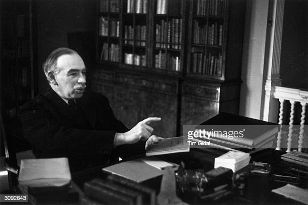 English economist John Maynard Keynes 1st Baron Keynes at his desk Original Publication Picture Post 361 Mr Keynes Has A Plan pub 1940