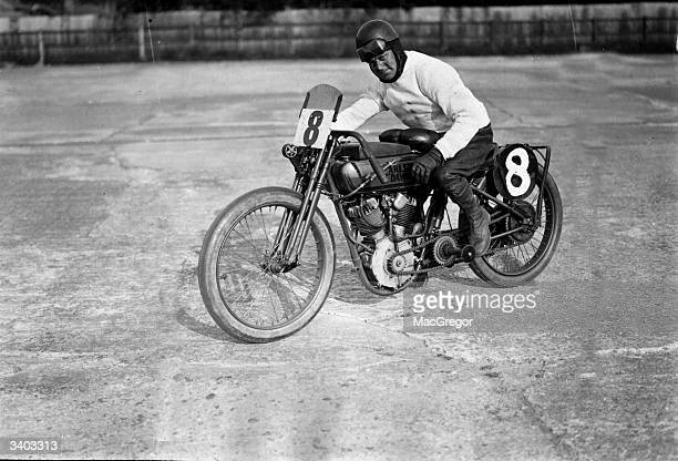 F A Longman on a Harley Davidson after winning a 100 mile race at a speed of over 90 miles per hour at Brooklands