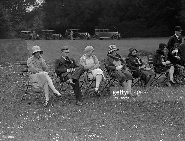 A group of spectators appear less than enthused by the spectacle of the Duke of Norfolk playing stoolball at Arundel Castle West Sussex