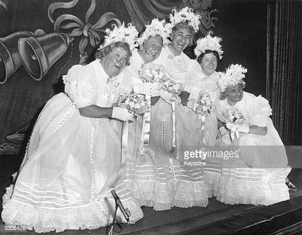 The Crazy Gang rehearsing for a sketch entitled 'Follow the Bride' at the Royal Variety Performance wearing dresses similar to the style worn by...