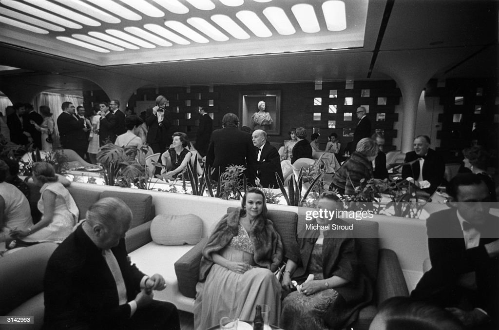 Passengers in the VIP lounge aboard the QE2 luxury liner.