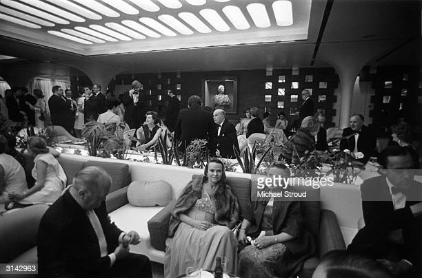 Passengers in the VIP lounge aboard the QE2 luxury liner