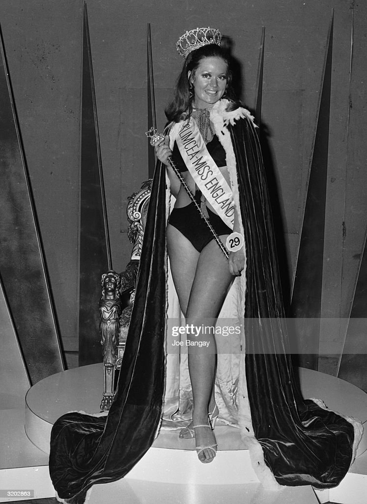 Playboy Bunny Girl Myra van Heck wearing her Miss England sash and crown after Angela Turner was mistakenly named as the winner.