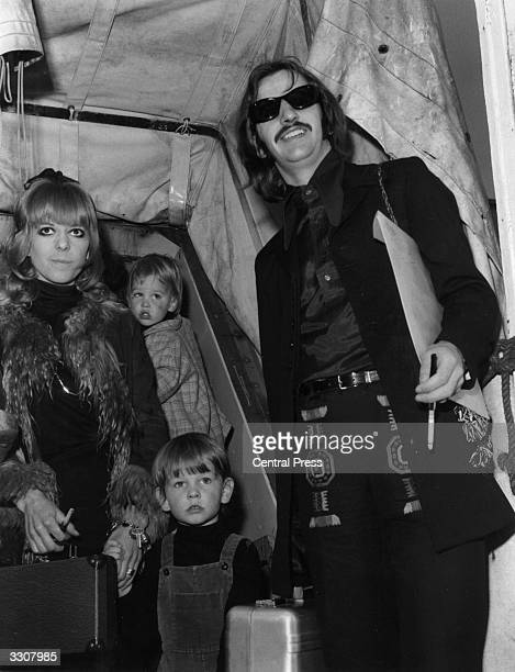 Ringo Starr drummer with The Beatles on board the QE2 with his wife Maureen and their two children Zak and Jason at Southampton before leaving for...