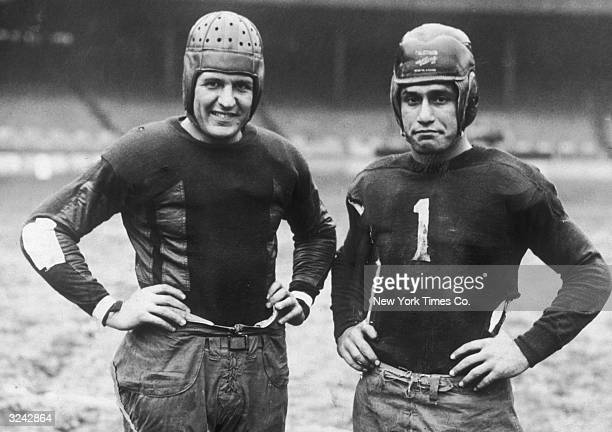 Portrait of football legend Harold 'Red' Grange captain of the Chicago Bears and Benny Friedman captain of the New York Giants