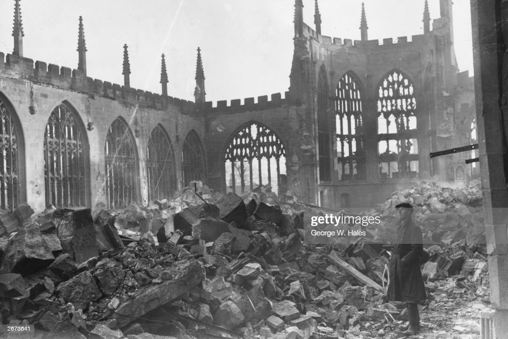 A man stands in the ruins of Coventry Cathedral after a German nighttime air-raid destroyed the centre of the city.
