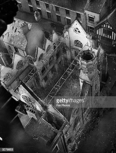 An aerial view of the damage done by the bombardment of Coventry showing St Michael's Baptist Church completely gutted