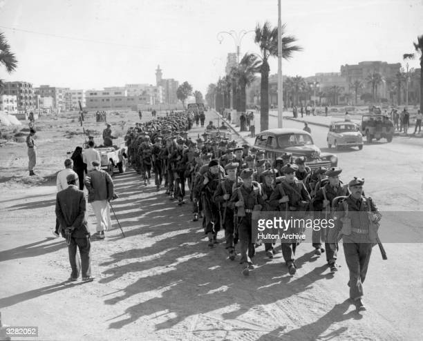 The 1st Battalion of the Royal Scots who have landed as replacement troops march into Port Said during the Suez conflict