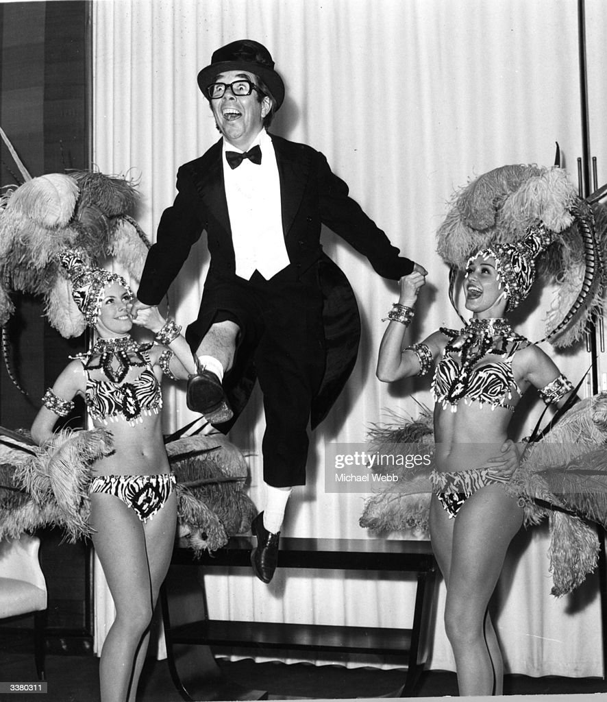 British comedian Ronnie Corbett dancing with two cabaret dancers during a rehearsal for his two week season at the Savoy Hotel London