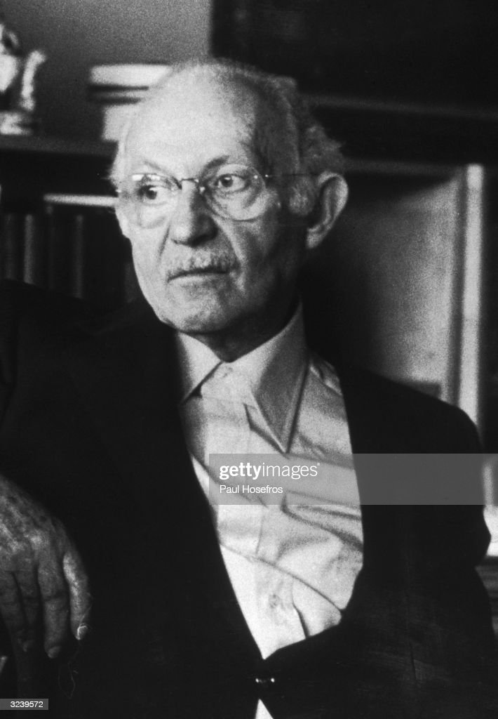 Austrian-born actor, drama teacher and stage director Lee Strasberg (born Israel Strassberg) sitting in a chair looking off camera.