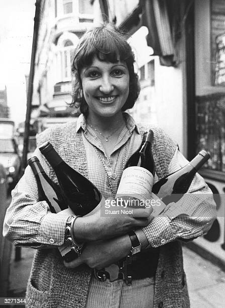 Judy Bray the owner of Bray's Wine Bar in Fulham Road London with an armful of Beaujolais Nouveau which has just arrived from France