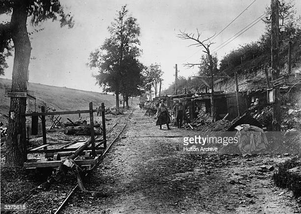 Huts and dugouts evacuated by retreating German troops beside a railway line