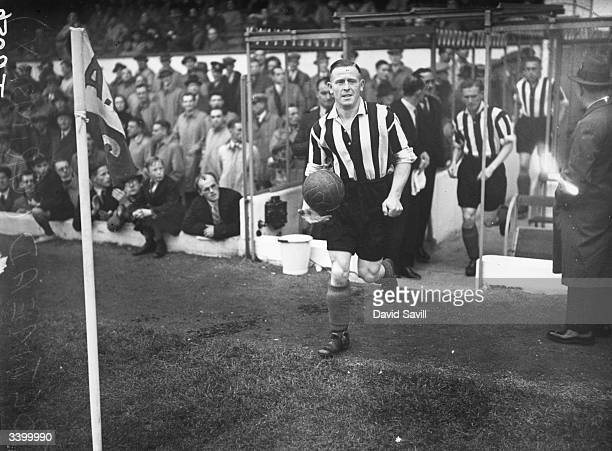 Grimsby Town FC team captain Hall leads his team out on to the pitch