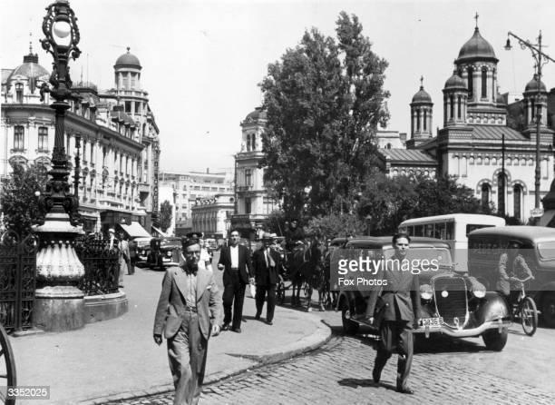 Pedestrians and traffic on Calea Victoria the main street of Bucharest Romania