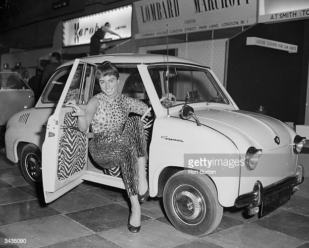 Model Jackie Collins at the Motor Show Earl's Court London wearing a leopard print outfit designed by Car Robes makers of car seat covers She is...