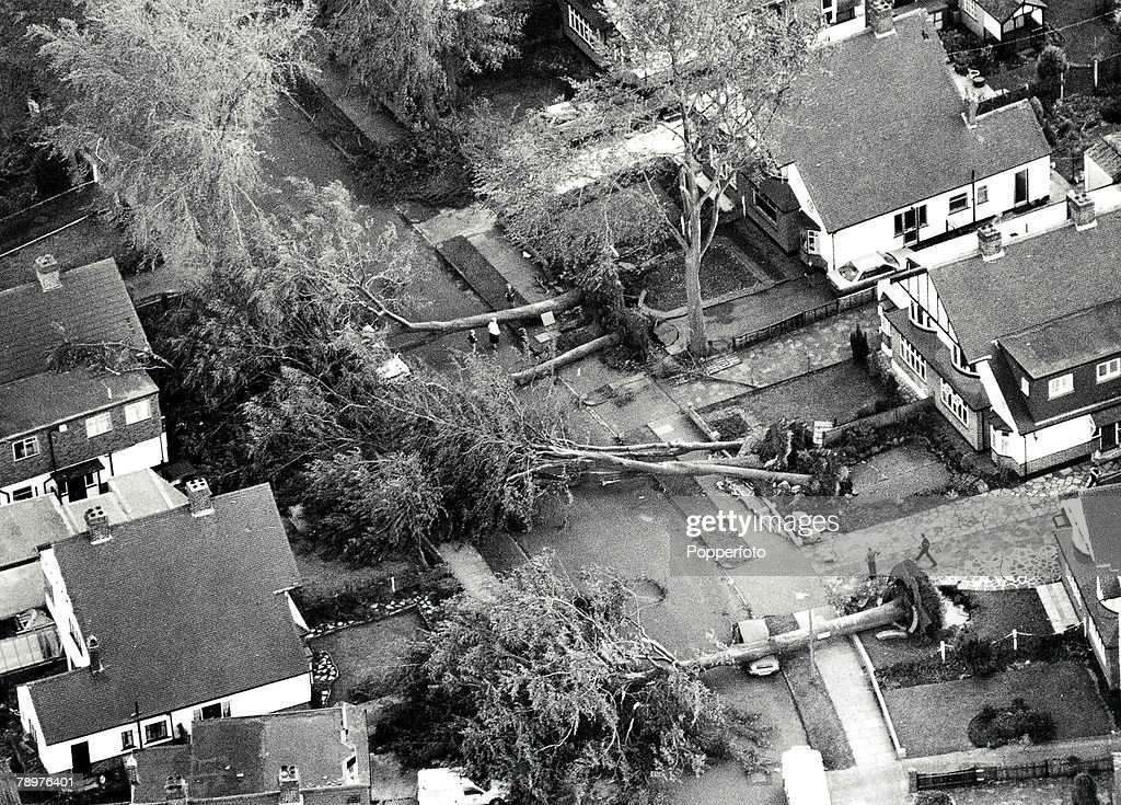 16th October 1987, Worst storms in 300 years in Britain, picture shows damage in a residential street in a South London suburb of Orpington which felt the force of hurricane force gales as trees lie uprooted over cars