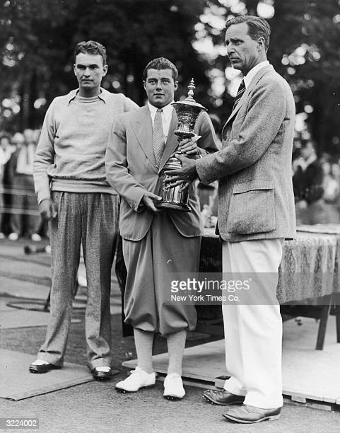Stanford University student Lawson Little accepts the National Amateur Golf Championship trophy from Prescott Bush President of the United States...