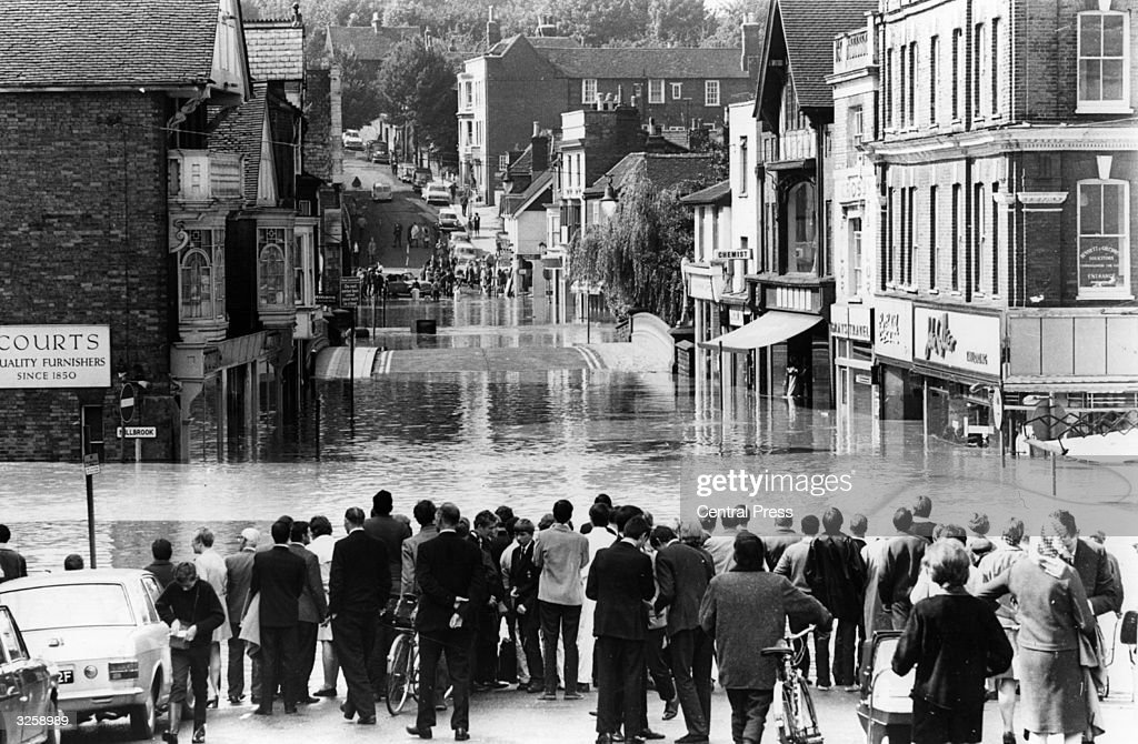 The main street in Guildford in Surrey after the river Wey overflowed its banks following a deluge of rain, causing heavy flooding.