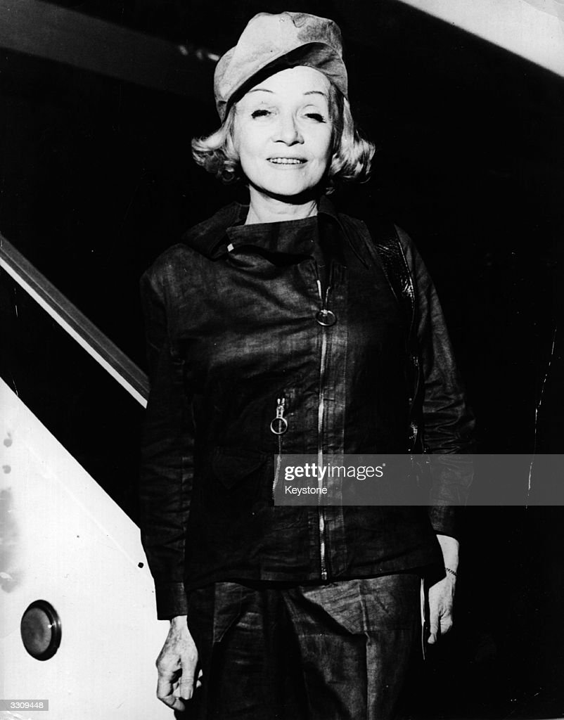 Marlene Dietrich (1901- 1992) leaving an aeroplane at Orly airport, wearing an original Mao-style suit.
