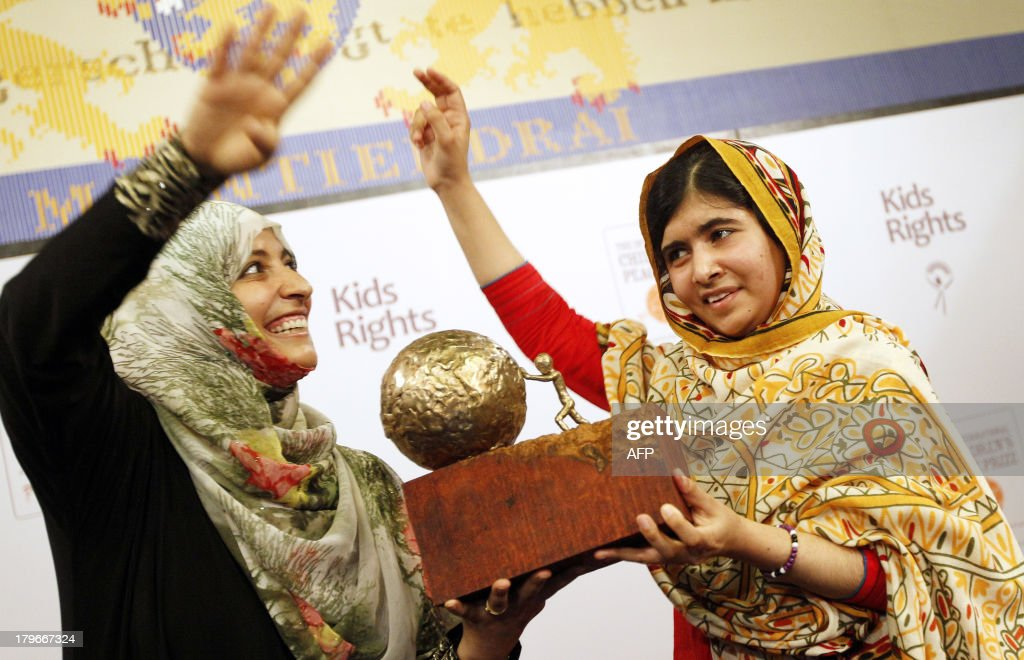16-year old Malala Yousafzai (R) from Pakistan receives a trophy from Yemeni Civil Rights activist and 2011 Nobel Peace Prize winner Tawakkul Karman after being honored with the International Children's Peace Prize at the Ridderzaal in the Hague, the Netherlands, on September 6, 2013. Malala was attacked by Taliban on October 9, 2012, for advocating girls rights to education and wounded along with two schoolmates.