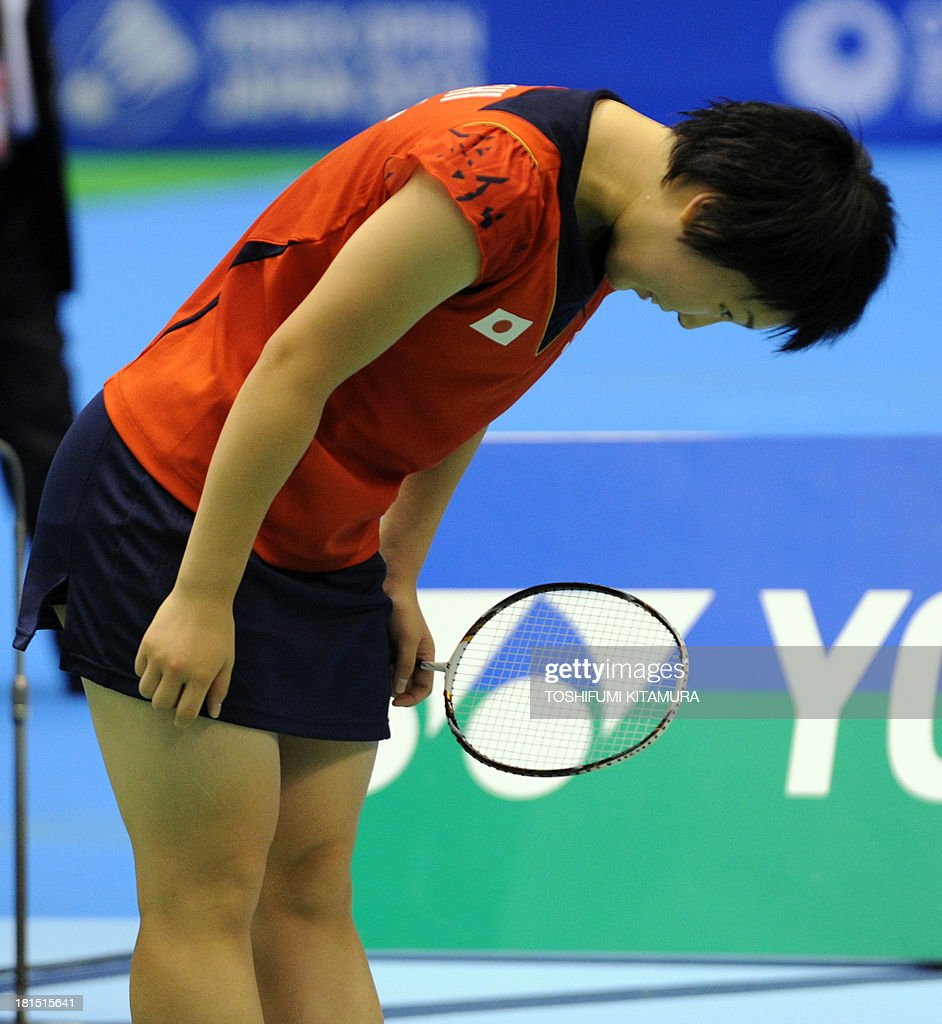 16-year-old Akane Yamaguchi of Japan bows after her victory over Shizuka Uchida of Japan during their women's singles final match at the Japan Open 2013 badminton tournament in Tokyo on September 22, 2013. Yamaguchi won by 21-15, 21-19.