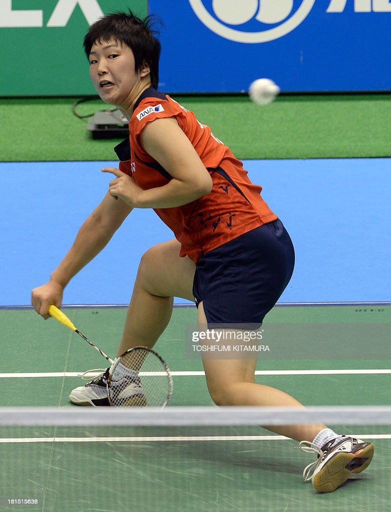 16 year old Akane Yamaguchi of Japan hits a return during her